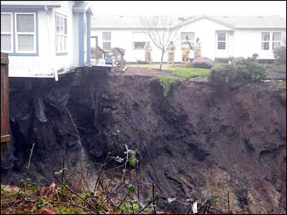 Eight homes evacuated as sinkholes emerge in Newport