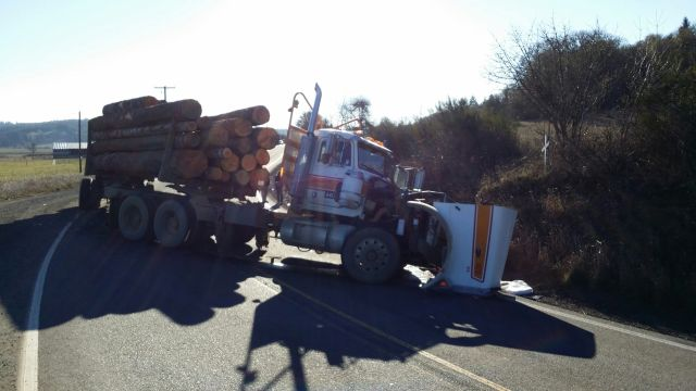 SUV driver killed in head-on crash with log truck