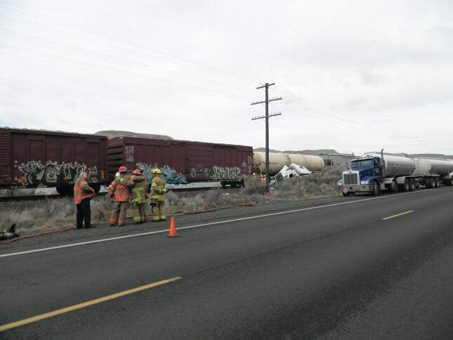 Truck hauling jet fuel hit by train