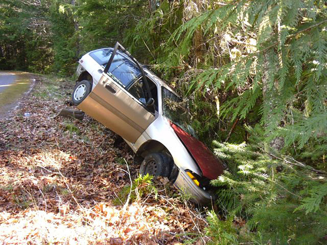 Injured driver spends night in woods next to crashed car