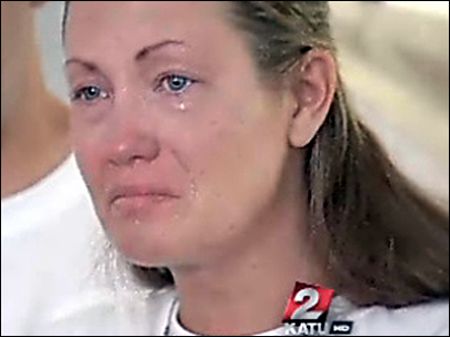 Kyron's biological mother sobs in front of news conference cameras
