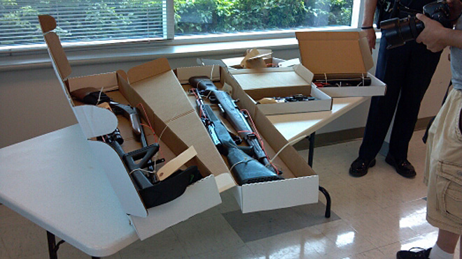 Officers seized boxes full of firearms during raids across Oregon and southeast Washington.