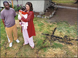'KKK' burned in couple's lawn