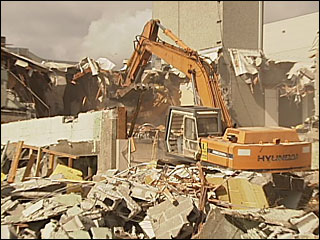 Crews demolish old police station