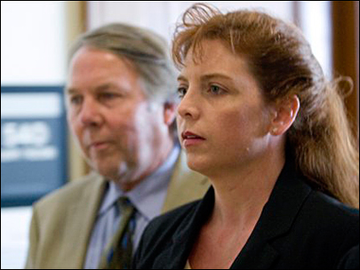 Terri Horman accompanied by attorneys Peter Bunch, left, and Stephen Houze, not seen, leaves the Multnomah County Courthouse