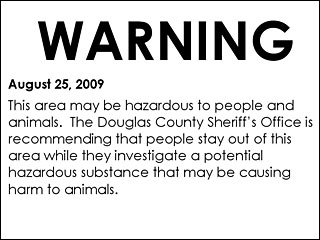 Sheriff posts warning signs where dogs died