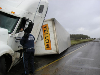 Trucker chokes on chicken, passes out, crashes