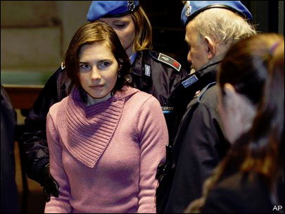 amanda knox images. Amanda Knox is escorted by