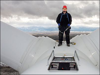 Wind farm worker climbs high to get job done