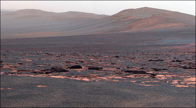 Mars rover beams back new photos from crater