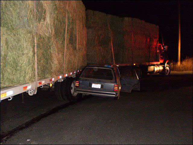 Driver killed in crash with hay truck