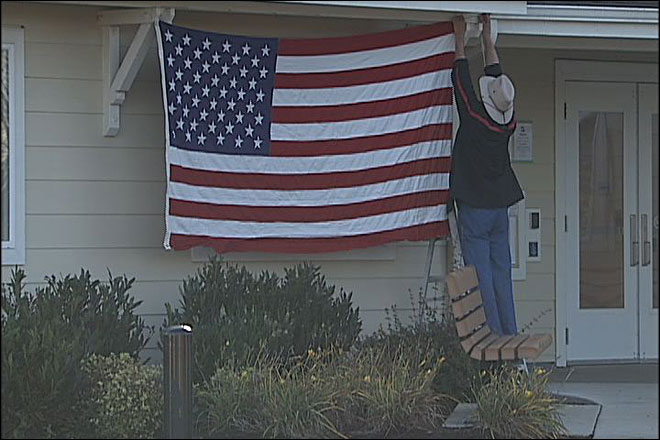 Navy vet told: Take U.S. flag down or face eviction