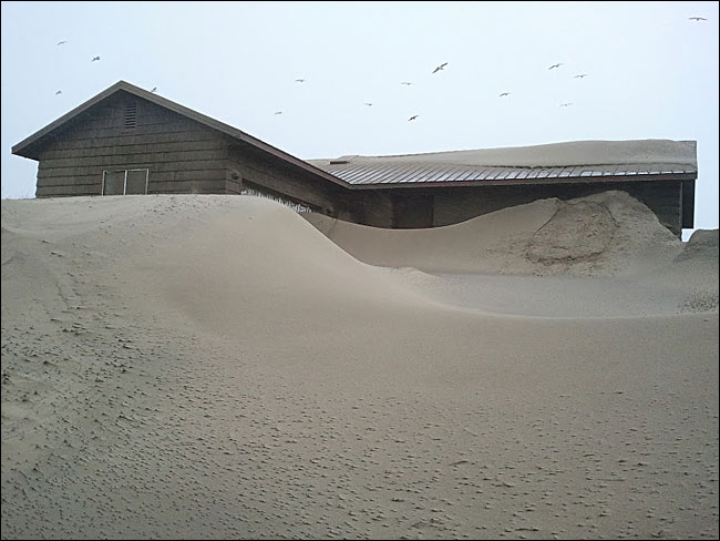 Storm buries homes: 'Worst I have seen it with the sand'