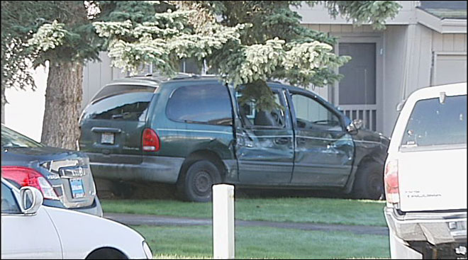 Police: Driver in stolen rig hits parked vans, house