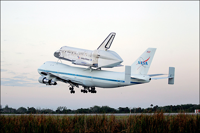 Iconic space shuttle Discovery makes final flight to museum