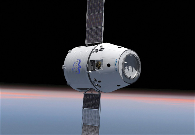 Private supply ship flies by space station in test