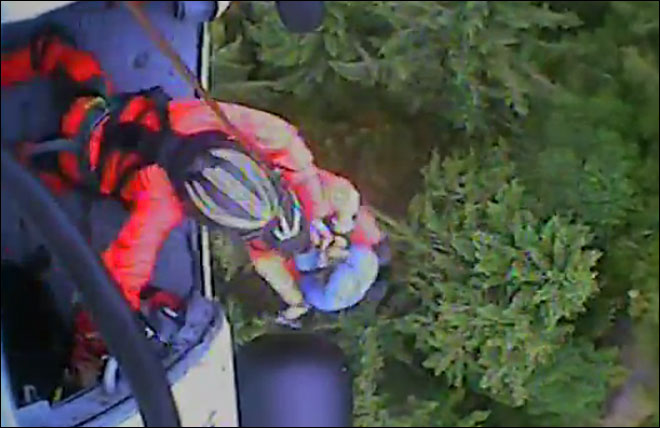 Coast Guard helicopter hoists hiker to safety