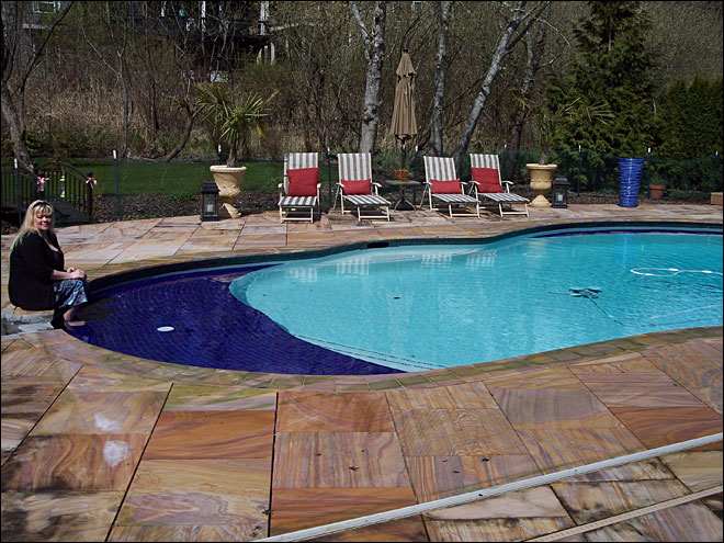 City fines Oregon couple $2K per day for $100K swimming pool