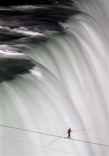 APTOPIX Niagara Falls Tightrope