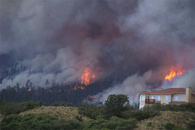 Wildfires scorch three states: 'it's like nothing I've seen before'