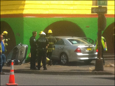 Restaurant remains open after car crashes into wall