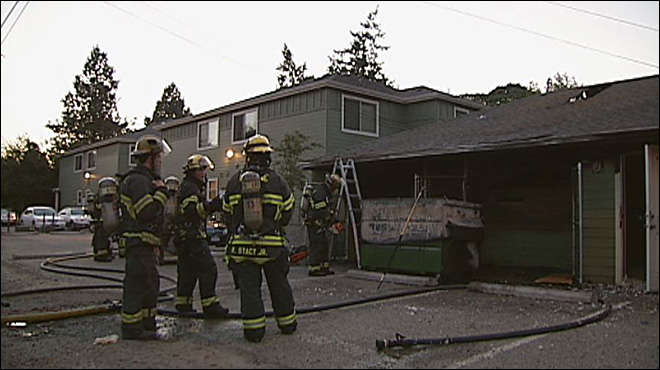 Fire in trash bin burns apartment storage
