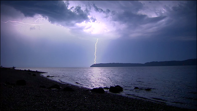 Thunderstorms light up the skies over Puget Sound