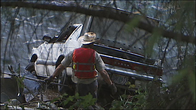 Crews fish car out of reservoir after high-speed chase