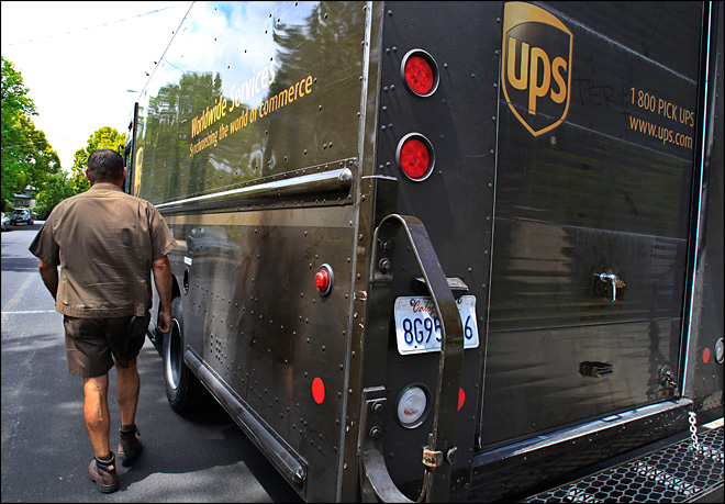 UPS to end health coverage for working spouses