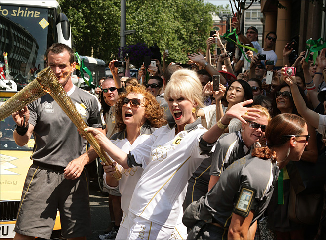 Victory lap: Olympic torch cheered through London