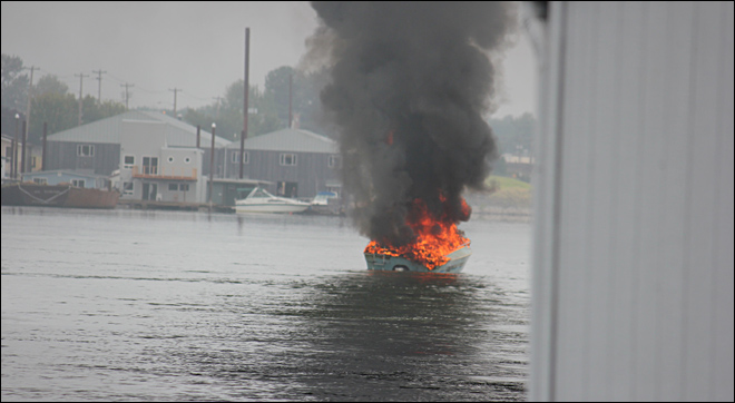 Passengers jump from burning boat
