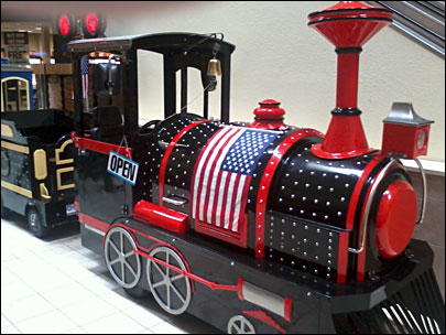 Mall responds to uproar, says U.S. flags can stay on kiddie train