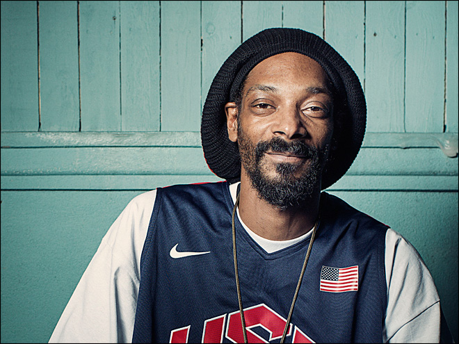 Snoop Dogg blazes one during on-air songwriting panel