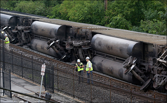 2 college students killed when coal train crashes off bridge