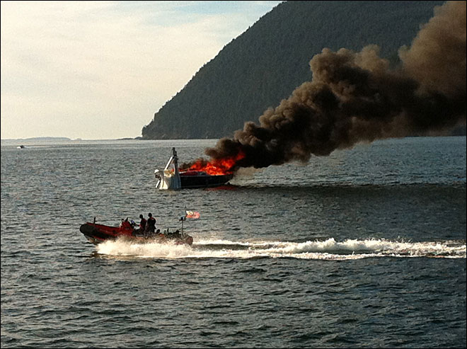 Coast Guard: 7 jump overboard to escape burning sailboat