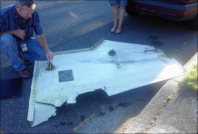 Aircraft part falls in NW neighborhood