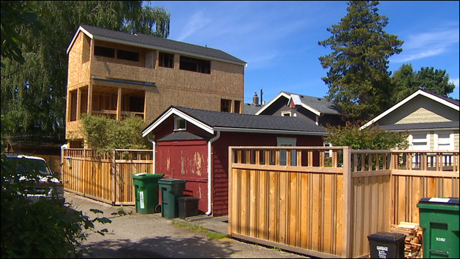 Neighbors declare war against tall, skinny homes