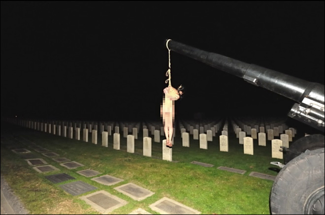 Bondage photos shot in cemetery anger families of dead