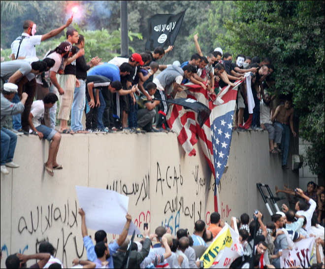 Egyptian protesters scale U.S. Embassy wall in Cairo