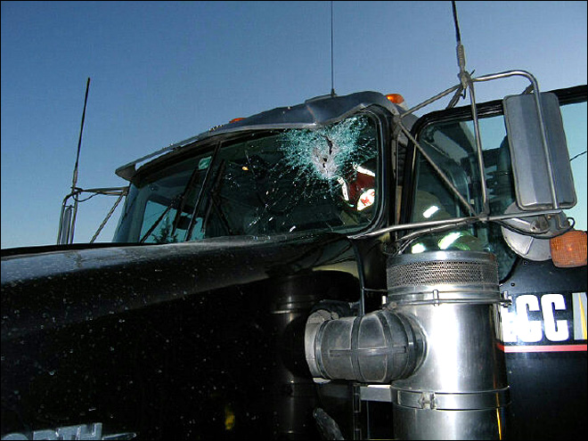 Trailer hitch smashes through truck's windshield on I-5