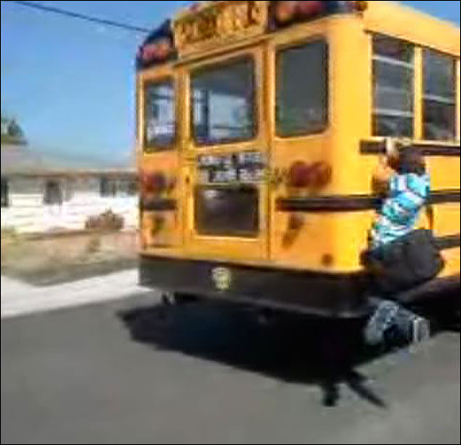 Caught on camera: Eugene boy hangs from side of school bus