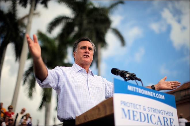 Romney tries to seize mantle of change