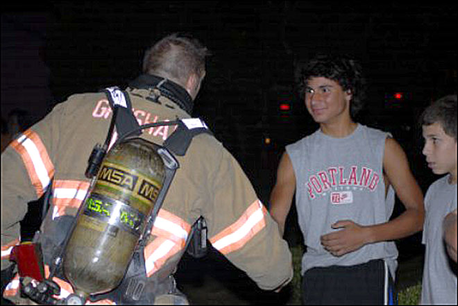Boy Saved from Fire
