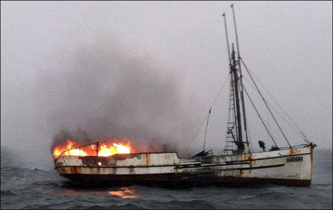 Coast Guard pull three from raft after fishing boat catches fire