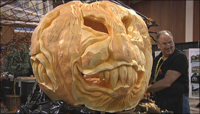 World record carver slices and shaves a half-ton pumpkin