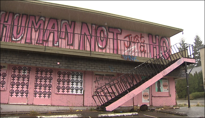 Group tags vacant motel in support of respect for sex workers