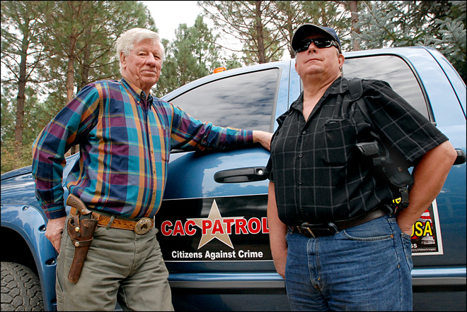 Armed posse patrols timber land in sheriff's place