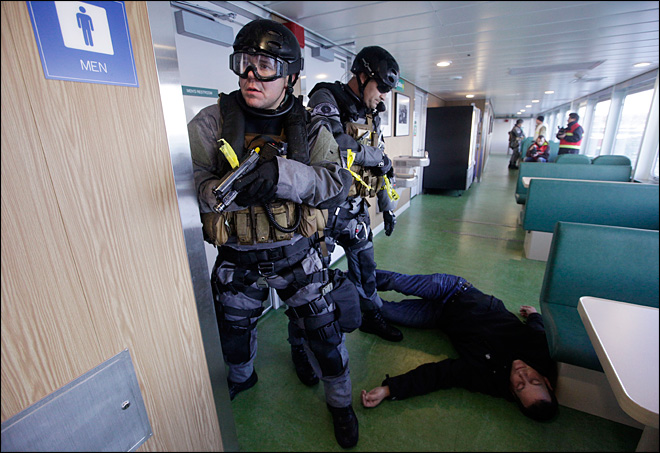 SWAT teams storm ferry in terrorism drill
