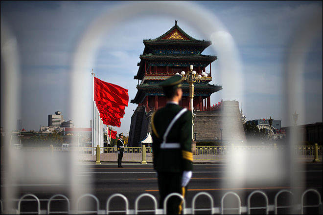 China's power transfer: infighting and spectacle