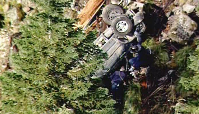 Man dies after vehicle rolls 25 times down embankment